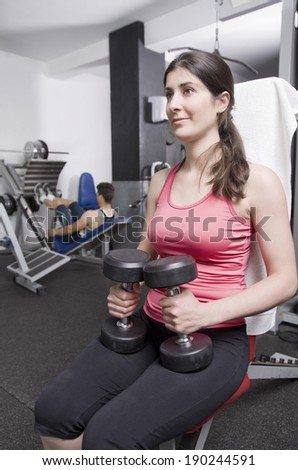 Woman posing in gym room ready for fitness exercises
