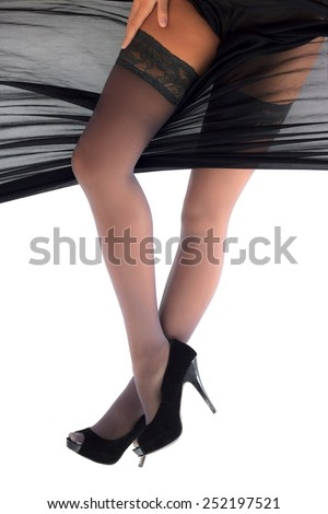 Woman posing in shoes and stockings wrapped in silky cloth view 1 - stock photo