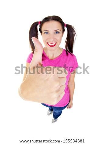 Woman posing in studio using fisheye lens giving thumbs up - stock photo
