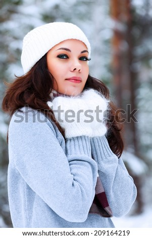 Woman posing outdoors - stock photo