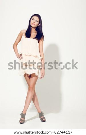 woman posing wearing dress studio shot - stock photo