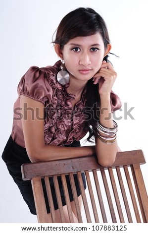 woman posing with a chair,  isolated on white background