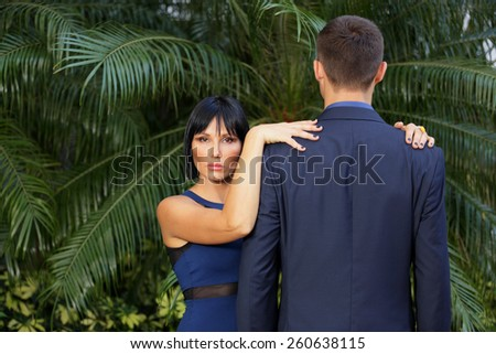 Woman posing with an unidentifiable man - stock photo