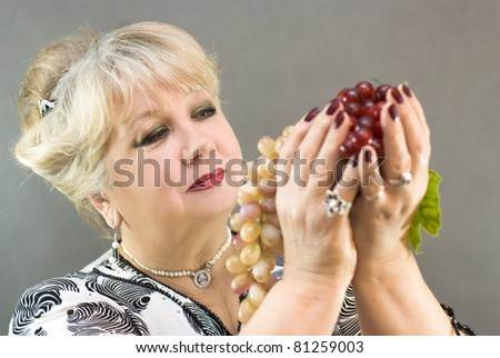 Woman posing with grapes - stock photo