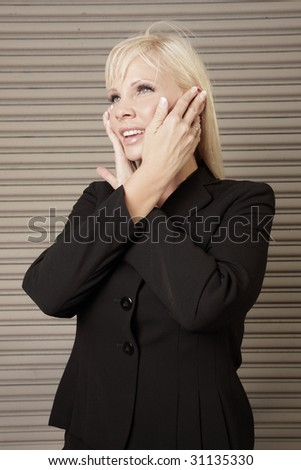 Woman posing with her hands on her face - stock photo