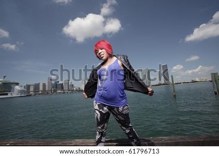 Woman posing with her jacket unbuttoned - stock photo