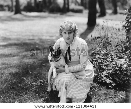 Woman posing with herJack Russell terrier - stock photo