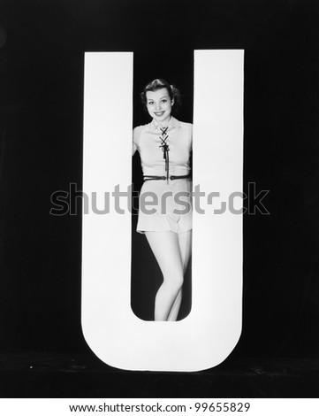 Woman posing with huge letter U - stock photo