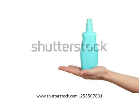 woman pouring body lotion on hand isolated on white background - stock photo