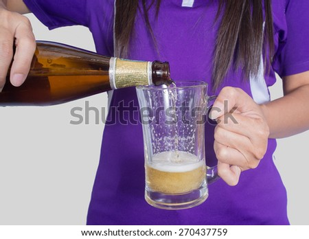 Woman pours beer. - stock photo