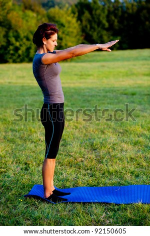 Woman practice yoga outdoor in park