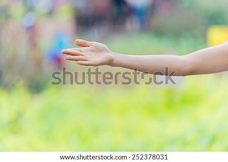 Woman practices yoga outdoors. - stock photo