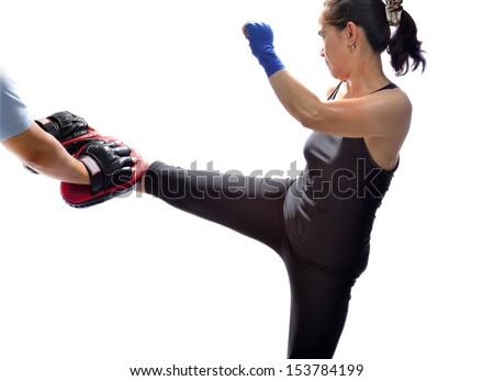 Woman practicing Thai boxing technique.(muay Thai) - stock photo