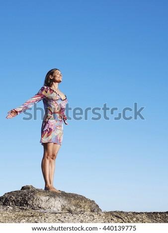 Woman practicing yoga - stock photo