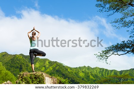 Woman practicing yoga in the mountains of Hawaii. - stock photo