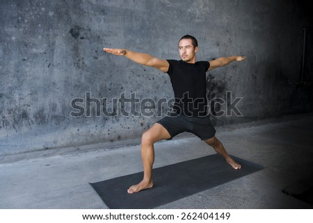 Woman practicing yoga outdoors - stock photo