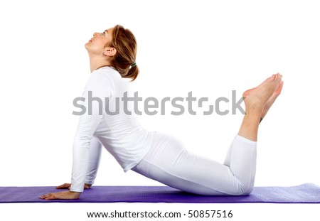 Woman practicing yoga over a mat - isolated on a white background