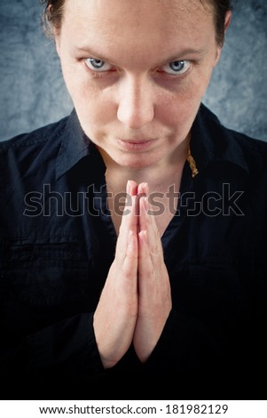 Woman praying and praising the God. Religion, spirituality concept.