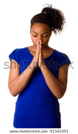 woman praying isolated on a white background.