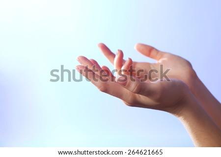 Woman praying on bright background - stock photo