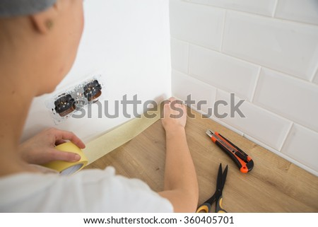 Woman   preparation for painting, paint wall at home.