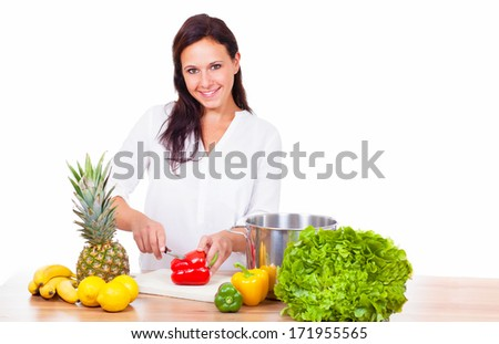 Woman prepares a healthy meal - stock photo