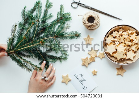 Woman preparing accessories for Christmas decorations