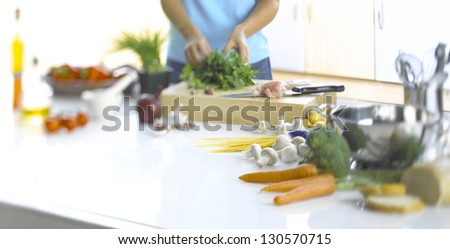 woman preparing food on a kitchen counter - stock photo