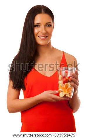 Woman preparing healthy fresh fruit smoothie isolated over white.