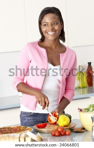 Woman Preparing Meal In Kitchen - stock photo