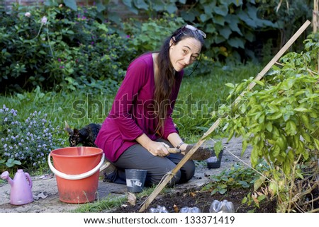 Woman preparing the ground by the arrival of spring - stock photo