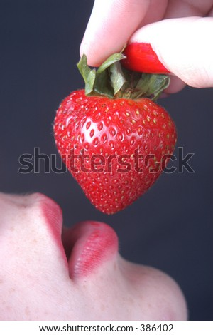 woman preparing to eat strawberry