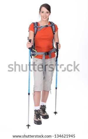 Woman preparing to go hiking - stock photo