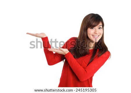 Woman presenting empty placeholder product on white background - stock photo