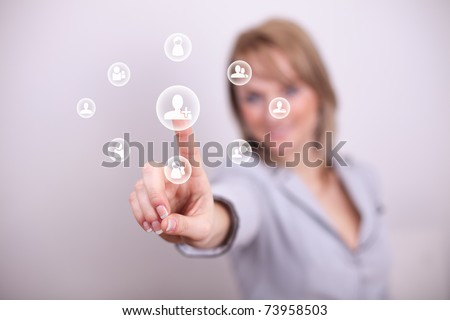 Woman pressing add friend button with one hand