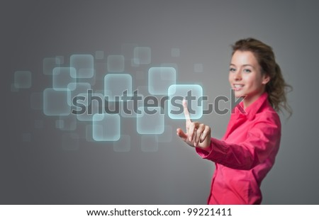 woman pressing buttons on a virtual screen - stock photo