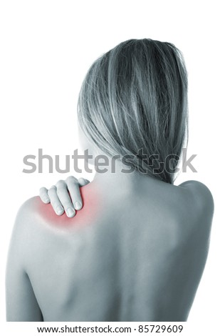 Woman pressing her hand against a painful shoulder - stock photo