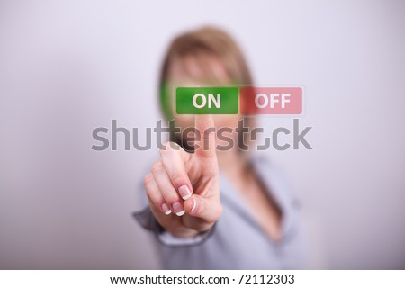 Woman pressing on off button with one hand