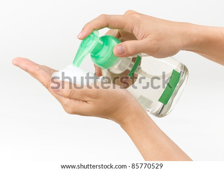 woman pressing the liquid soap to her hand - stock photo