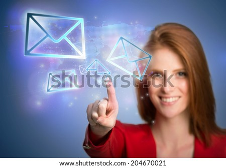 Woman pressing virtual email icons - stock photo