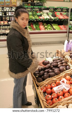 Woman produce shopping in supermarket - stock photo