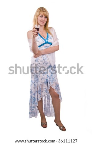 Woman proposes a toast to smb's health. Girl in white dress is standing and holding a glass of wine. Isolated on white background. - stock photo