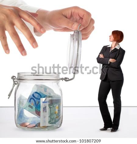 Woman protecting her savings, concept image - stock photo