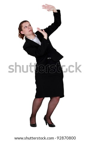 Woman protecting herself with raised hands - stock photo
