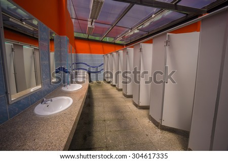 Woman public toilet in open air aqua park in tropics