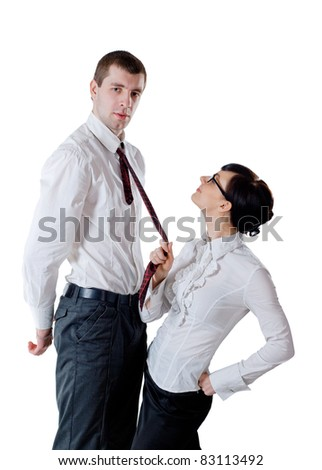 Woman pull a tall man by necktie