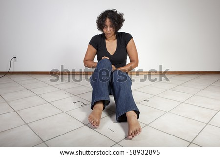 woman pulling on her jeans - stock photo