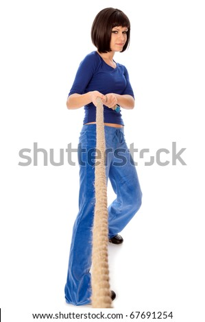 woman pulling opposite ends of a rope for became a winner - stock photo