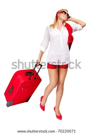 Woman  pulling vacation suitcase talking on phone. Isolated on white - stock photo