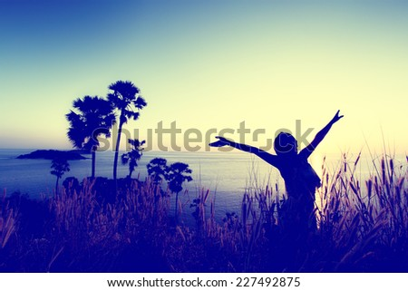 Woman pulls hands to the sky. Freedom - conceptual photography (Vintage color) - stock photo
